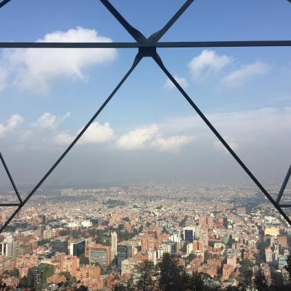 Bogotá, framed by the beams of a communication tower